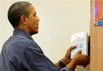 President Barack Obama holds Dr. Palmisano's book ON LEADERSHIP.  Also see page 49 THE LITTLE RED BOOK OF LEADERSHIP LESSONS.  Photo reproduced with permission REUTERS/Jonathan Ernst.
